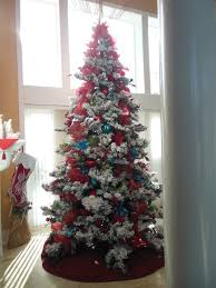 Glamorous flocked christmas tree in Spaces Traditional with next ...