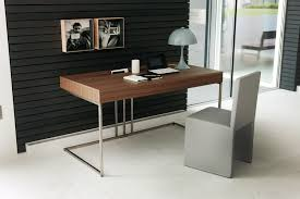 modern home office ideas with small writing desk design and black accent wall using stylish wall photos