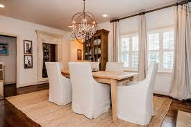 traditional dining room with pendant light carpet in mountain with regard to new house foucault orb chandelier ideas