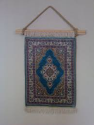 picture of hanging fringed rug on wall