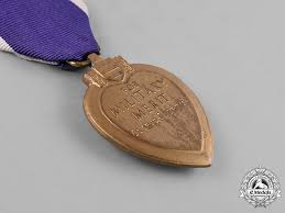 a purple heart to george j curtis 91st greentree division c 1944