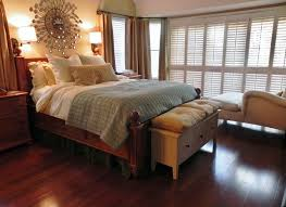 muted colors plantation shutters mounted bedside lamps relaxed cozy traditional bedroom bedside lighting wall mounted