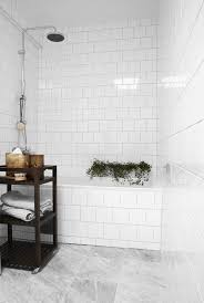 white square tile shower enclosure + marble floor + no curtain/glass