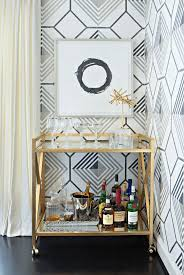 Art deco inspired wall paper and gold bar cart | Home Decor | Interior  Design