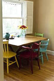 i want mismatched chairs around a wooden table like this very cute kitchen table idea maybe add a bench along the wall side