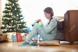 Untangle Christmas Tree Lights Girl Sitting On Living Room Floor Untangling Christmas Lights