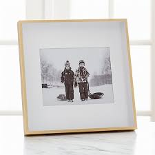 entranching 8 x 10 frames on brushed brass picture crate and barrel home