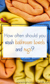 how often should you wash bathroom towels and rugs