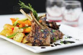 Grilled Lamb Chops With A Side Of Vegetables Stock Photo