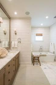 coastal bathroom designs: bright and airy beach house design in lafittes point texas