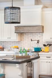 Decorating for the Seasons in Julie's White Kitchen | Kitchen ranges,  Mantels and Hoods