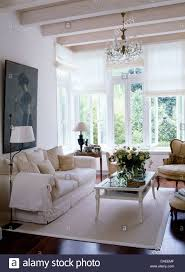 Lime Wash Coffee Table Coffee Table On White Rug In Front Of White Sofa In Country Living