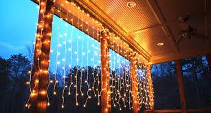 hang curtain lights across the deck