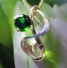 jewelers chrome diopside pendant with 14k yellow gold and sterling silver and purple sapphire accent