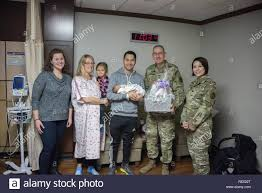 Brig. Gen. George N. Appenzeller, Brooke Army Medical Center commander,  along with Sarah Kelly, BAMC auxiliary president, and Master Sgt. Melinda  Griffin, enlisted advisor to the deputy chief for patient support, present