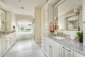 bathroom vanity remodel. Master Remodel Bathroom With Large Window And Double Sink Vanity Under Mirror Also White Wall Tile B