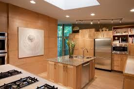 oak kitchen cabinets with white island