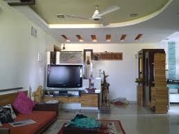 drawing room with pop colors trends and stunning false ceiling