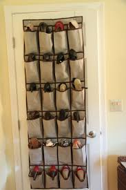 furniture gray fabric shoe organizer bags with many shelves placed on the white wooden door
