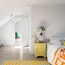 attic furniture ideas. create a yearround holiday feel escape to this attic bedroom with its zingy palette of tropical colours the bold yellow and orange decor pops in an furniture ideas