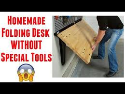 a wall mounted folding desk diy table