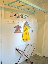 Ladder Drying Rack - Laundry can take over your entire house. Rebecca  Kuenzi solved that problem by hanging an old ladder from her ceiling,  allowing her to ...