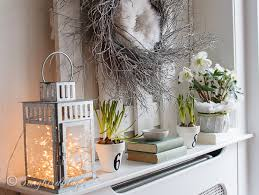 Lovely Spring mantel idea: twig wreath combined with a feather wreath and  with fresh flowers