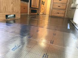 installing vinyl planks isn t rocket science i started next to the large slideout since this was the longest wall using the tounge and groove system