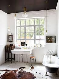 unique cowhide rug and black tub for vintage bathroom design with black best ceiling paint