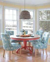 she adds instant elegance and presence to your coastal dining room with a round pedestal silhouette