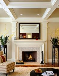 white tiles fireplace surround with black frame mirror in light brown living room with