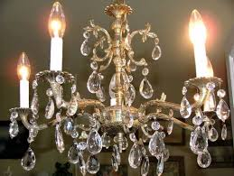 image of faux antique brass chandelier
