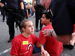 file police officer speaking to demonstrator during civil  file police officer speaking to demonstrator during civil disobedience action jpg