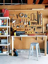 Different types of storage (wall, shelves, workbench). Nice use of vertical
