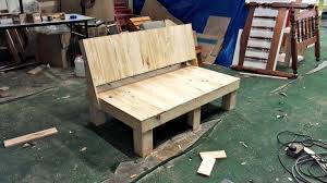 the sofa has been build from the pallet thick pieces like the boards with a plain big back a wide seat and the four small dice sections like legs at the