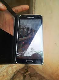 samsung galaxy s5 white used. fairly used samsung galaxy s5 white and black for sale very cheap - technology market nigeria s