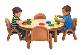 children sitting at natural wood round value table baseline table and chair sets