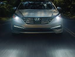 hyundai sonata 2015 silver. exterior action shot of silver hyundai sonata 2017 four door sedan driving through a forest 2015