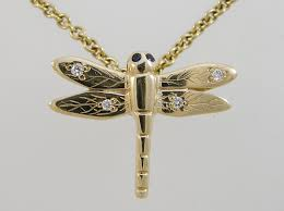 9ct yellow gold dragonfly pendant with diamonds and sapphires