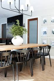 i love the modern lower curved backs that are really supportive the slightly tapered legs that we can fit 8 easily at our table and they can stack when we