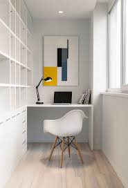 ultra minimalist office. ultraminimalist home office with a large builtin sheving unit and floating ultra minimalist
