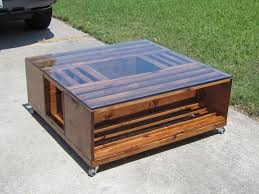 crate coffee table with a glass top