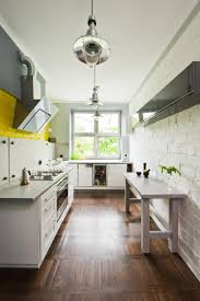 Painted Brick Backsplash Together With Industrial Galley Kitchen And White  Cabinet Colors Also Yellow Tone Accent Andwod Floor Laminate And Large  Glass ...