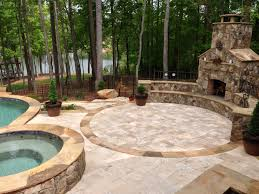 outdoor living room and pool seating walls stone pavers fireplace