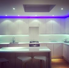 lighting cool kitchen with blue led lights decor on backsplash and above white wall storage