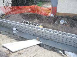 how to build a concrete block retaining wall build the footing and insert into the wet