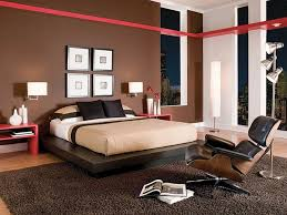 Modern Bedroom Design With Brown Wall Color White Bed And Brown Quilt With  Red Wall Accent And Lazy Chair Brown Rug Image