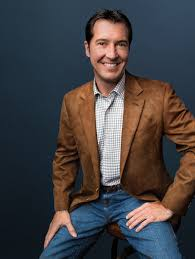 Travis R. Godley - Acadiana Profile