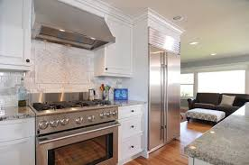 White Kitchen with Stainless Steel Appliances Pict