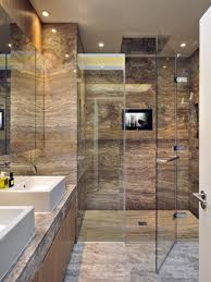 Trendy master brown tile and travertine tile travertine floor walk-in  shower photo in London